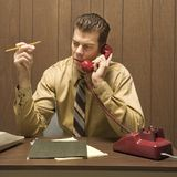 Retro business scene of man at desk. Royalty Free Stock Image