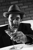 Retro businessman with drink. Stock Images