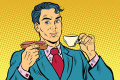 Retro businessman eating Breakfast, coffee and sausage sandwich Royalty Free Stock Images