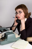 Retro businesswoman on the phone. Royalty Free Stock Images