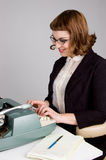 Retro Businesswoman typing. Royalty Free Stock Photo