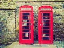 Retro cabina telefonica di Londra di sguardo Immagine Stock Libera da Diritti
