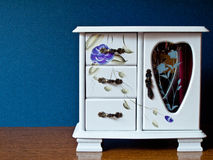 Retro cabinet. Retro white small cabinet with floral decoration royalty free stock photo