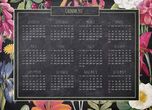 Retro calendar on blackboard background with floral border. 2017 yearly retro calendar on the blackboard background with colorful floral border stock illustration