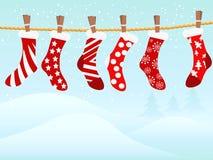 Retro calze di Natale nella nevicata Fotografia Stock Libera da Diritti
