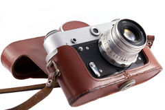 Retro camera. Used vintage film camera in leather case stock images