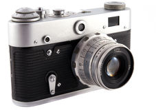 Retro Camera. Old 35mm film camera over white background stock photography