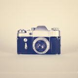 Retro Camera. Old film camera on vintage background Stock Photo