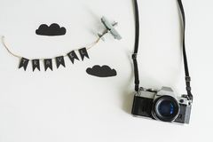 Retro camera with airplane toy on white background, Travel conce Royalty Free Stock Photo
