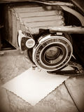 Retro camera on the background of old boards Royalty Free Stock Photos
