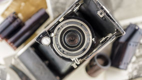 Retro camera on the background of old photos Stock Photo