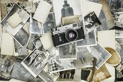 Retro camera on the background of old photos.  royalty free stock images
