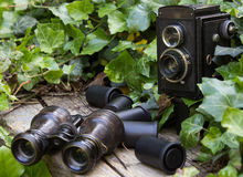 Retro camera and binoculars and photographic films Royalty Free Stock Image