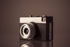 Retro camera. Retro camera on black background Royalty Free Stock Images
