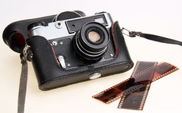 Retro camera in black case. Negative film Royalty Free Stock Photography