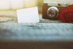 Retro camera with blank paper with space royalty free stock image