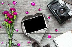 Retro camera and blank photo frame in heart shaped film Royalty Free Stock Images