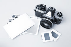 Retro Camera & Blank Photopaper Royalty Free Stock Images