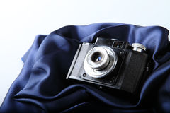 Retro camera on blue Royalty Free Stock Images