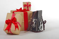 Retro camera and christmas gifts Stock Photography