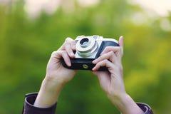 Retro camera close-up. Woman hand holding retro camera close-up royalty free stock photos