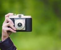 Retro camera close-up. Woman hand holding retro camera close-up Stock Image