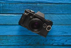 Retro camera on a colored wooden table, flat lay, top view. Minimalistic trend Stock Image
