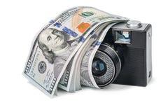 Retro camera with dollars Stock Photos