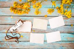 Retro camera and empty old instant paper photo album on wood table Royalty Free Stock Photography