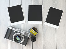 Retro camera, empty photo frames pictures and film canisterrs  o Stock Photos