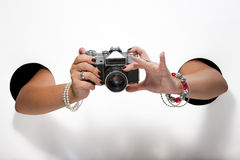 Retro camera in a female hands on a white background Stock Photo