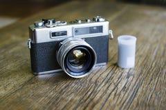 Retro Camera Beside a Film Canister stock photo