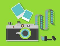 Retro camera with film. Camera with film with the film reel on a green background. Objects  on background. Flat vector illustration Royalty Free Stock Images