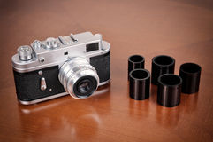 Retro camera and films. On the brown table. Vintage style photo royalty free stock photography