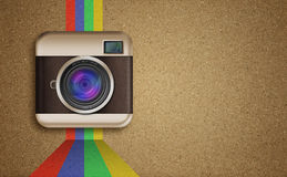 Retro camera icon with rainbow colors on corkboard Stock Photos