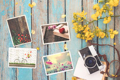 Retro camera and instant paper photo album of valentine day on wood table Stock Image