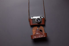 Retro camera in leather case Stock Photos