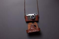 Retro camera in leather case Stock Photos
