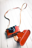 Retro camera in leather case Stock Images