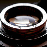 Retro camera lens close-up. Stock Images