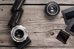 Retro camera lenses and negative film Royalty Free Stock Photos