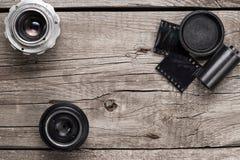 Retro camera lenses and negative film Royalty Free Stock Image