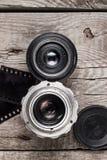 Retro camera lenses and negative film Stock Images