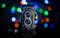 The old German medium-format TLR camera Rolleiflex. Retro camera model Rolleiflex in a colorful background Royalty Free Stock Photos