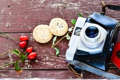Retro camera. Old retro camera  and  cookies on wooden background  photography creative concept Stock Photos