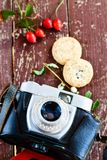 Retro camera. Old retro camera  and  cookies on wooden background  photography creative concept Stock Photo