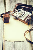 Retro camera on old wood background Stock Images