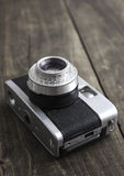 Retro camera. Over rustic wooden background Stock Photography