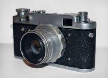 Retro camera. Retro photo camera on white background Royalty Free Stock Photo