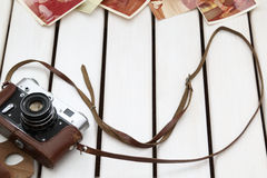 Retro camera and photos Royalty Free Stock Photo